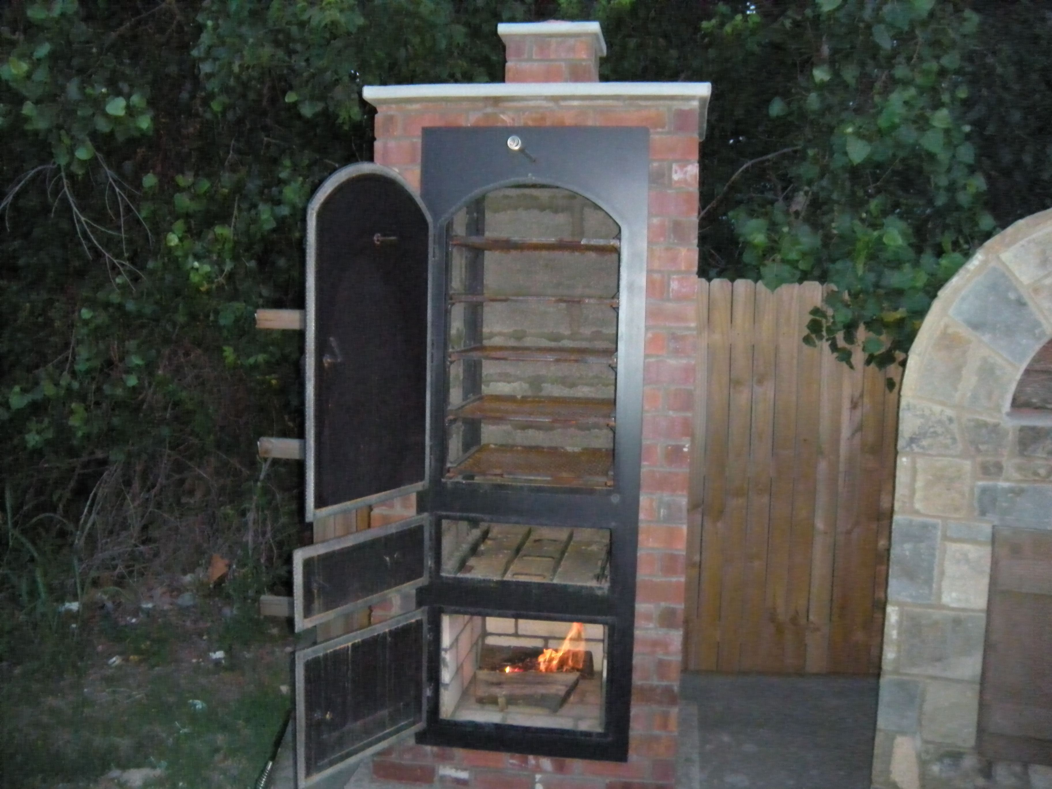 Stone age manufacturing big pig cabinet smoker under the stars