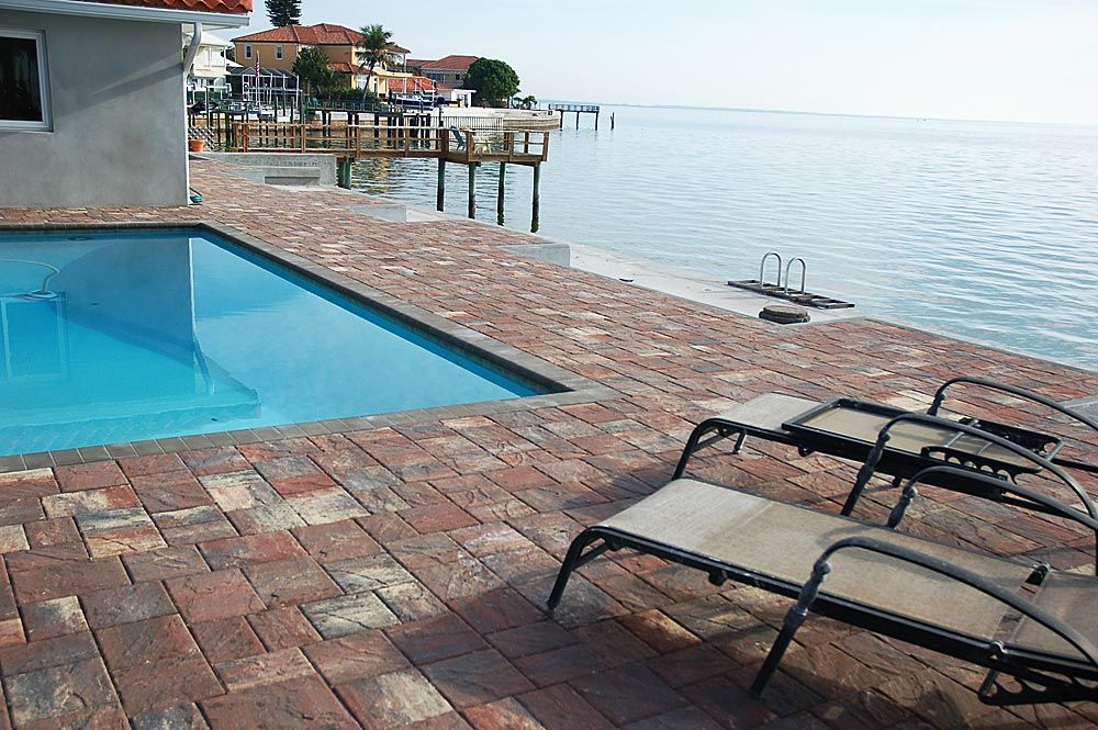 Stonehurst dark orange sand charcoal pavers installed in a for Florida pool and deck