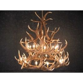 MUS229 Rustic Elk 18 Antler Chandelier with 21 Lights Our Rustic Elk 18 Antler Chandelier is the best faux antler chandelier available on the market. We have taken our replication process from our other rustic decor items and matched the authentic finish. Real antlers are used to model the reproduction after for an exact and comparable result. The process to create the chandeliers uses a time proven, cast resin system to ensure perfection in every piece.