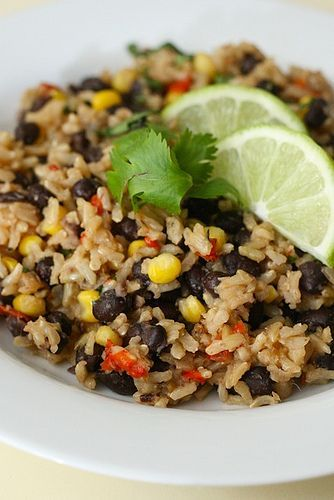 Rice with Black Beans 4 tsp. olive oil  1 cup onion, chopped fine  1 red bell pepper, chopped fine  3 cloves garlic, minced  1 cup low-sodium chicken broth  2¼ cups water  1½ cups long-grain brown rice  1 tsp. salt  1-2 (15 oz.) cans black beans, drained and rinsed  ¾ cup corn kernels (fresh from cob, or frozen and thawed)  ¼ cup chopped fresh cilantro  ¼ tsp