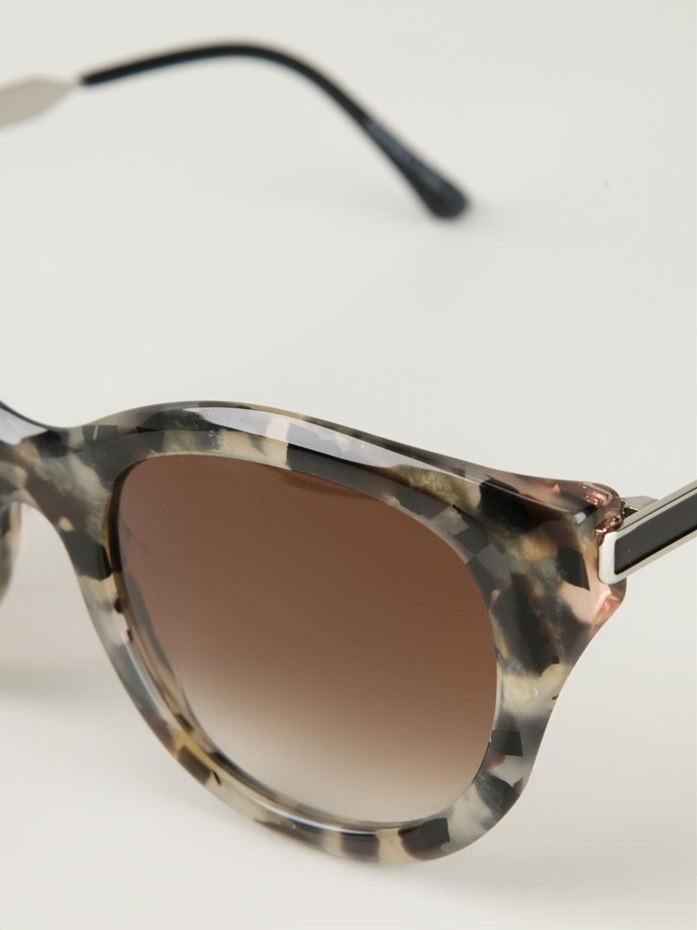 https://cdna.lystit.com/photos/59a4-2015/03/24/thierry-lasry-grey-tortoise-shell-sunglasses-gray-product-0-781284409-normal.jpeg