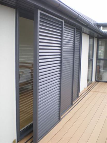 Sliding shutter doorways sliding shutters louvretec - Aluminum window shutters exterior ...