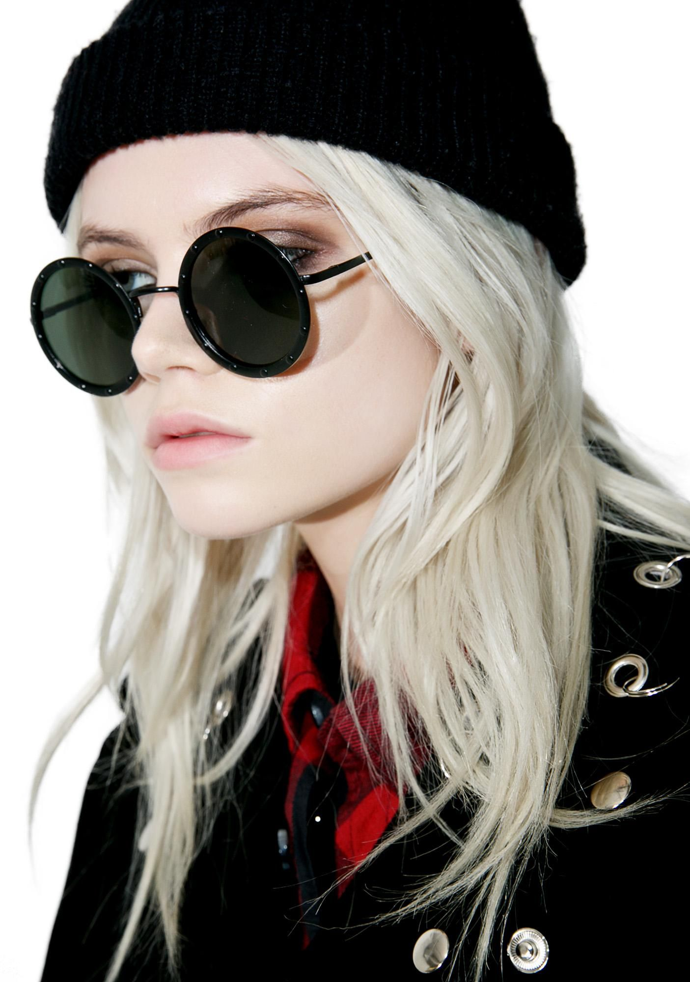 Blackout Johnny Sunglasses cuz it's a hard daze night, but it didn't stop you from lookin' pretty. These wavy sunnies feature black round frames with studded accents, straight nose bar, and tinted grey lenses.