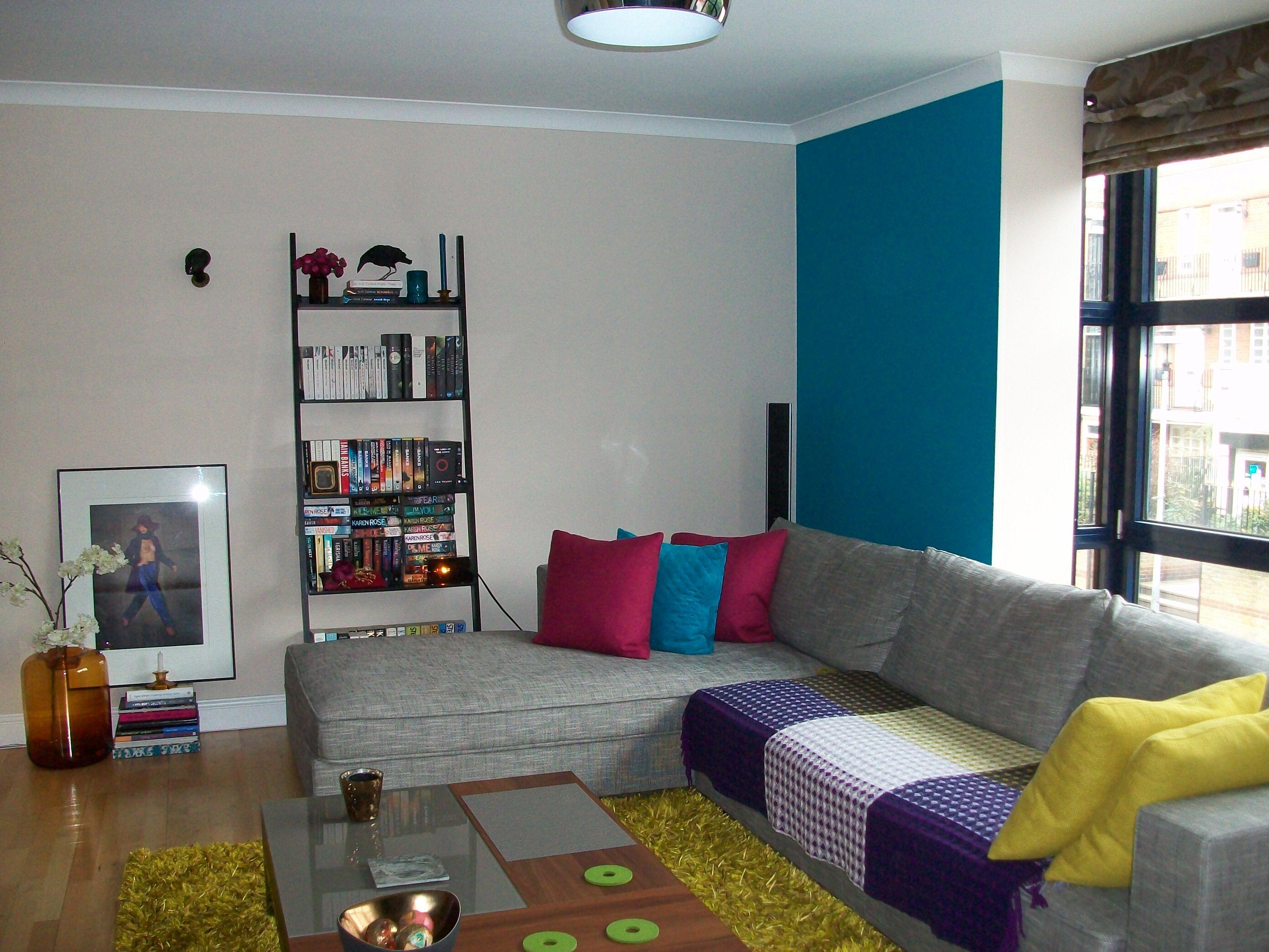 Ligne roset grey corner sofa green lime rug blue feature wall bold cushions grey corner sofaliving room