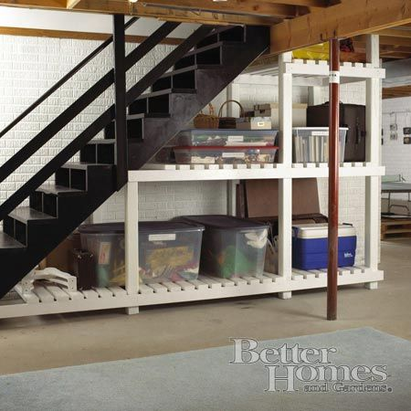 unfinished basement stairs decorating basement organization 18 creative ways to use the space under your stairs wood projects