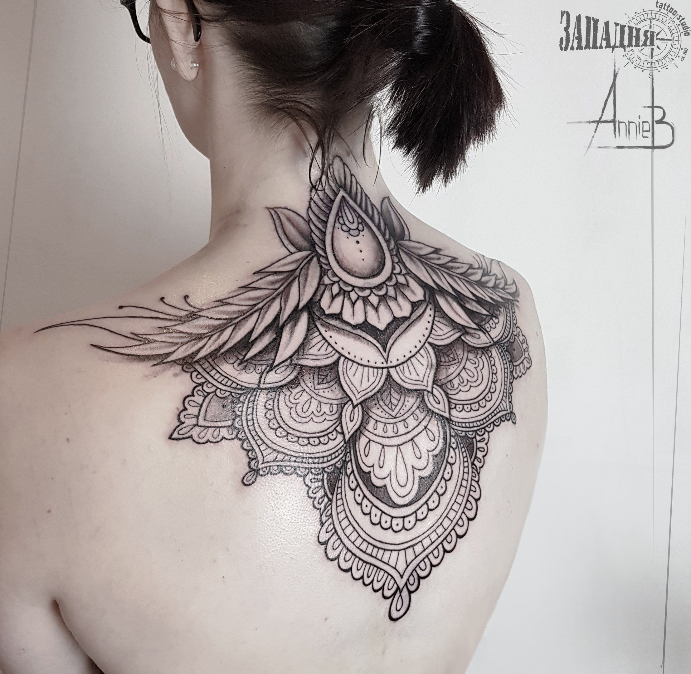 Ornamental tattoo on back by Anna Bubnova