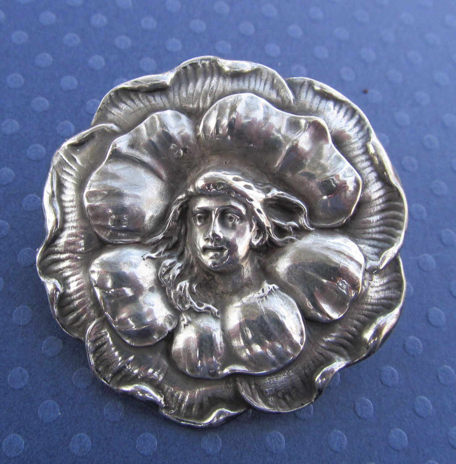 Art Nouveau Brooch Lady In A Flower Antique Sterling Silver Pin Circa 1910 by SarahAndJohns on Etsy https://www.etsy.com/listing/128558626/art-nouveau-brooch-lady-in-a-flower
