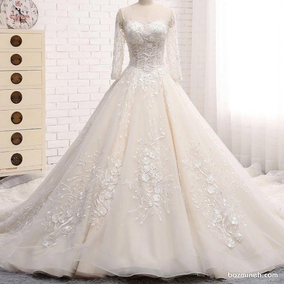 لباس عروس پوشیده آستین توری با گل های برججسته کار شده در دامن | لباس ...