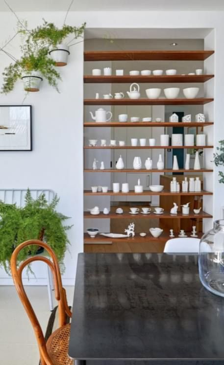Display your collections on shelves as a divider between rooms. This way you can see the collection from both sides. We have lots of collectable items available at our online shop - nancydesigns.co.za #decor #home #homedecor #interior #interiordecor #interiordesign #onlinestore #onlinedecor #homeinspiration #interiorinspiration Photo source Home & Garden October 2020