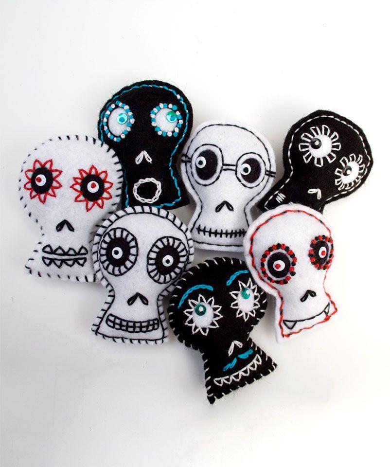 contemporary folk art, black and white embroidered felt skulls.