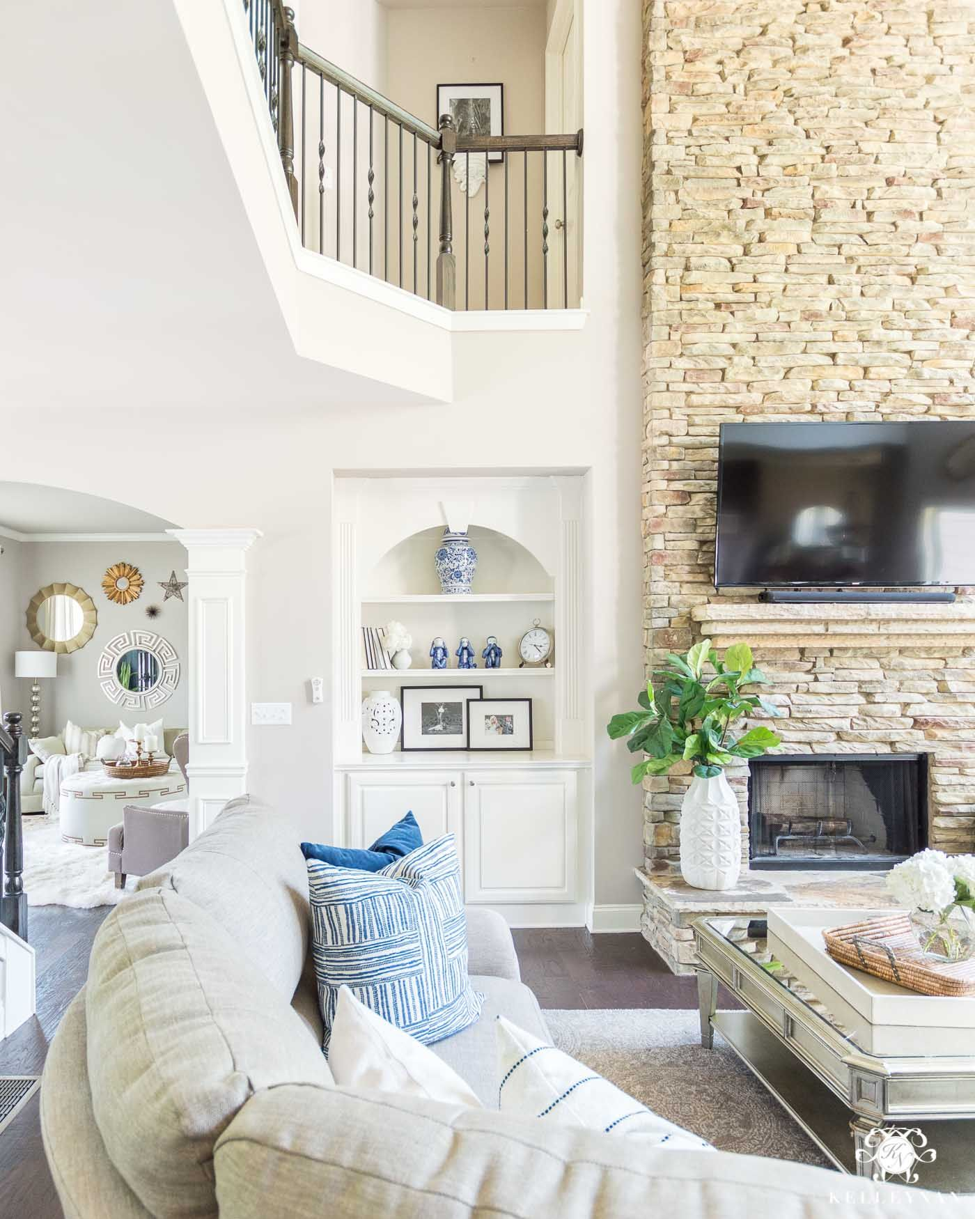 Family room game organization ideas in a two story living room with