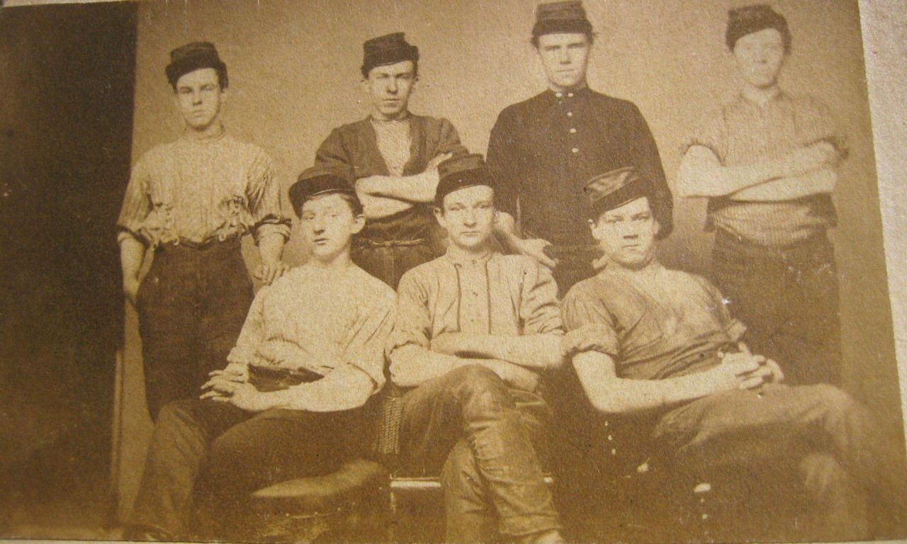 Group of seven young ohio soldiers all wearing bummers