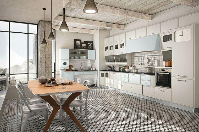 Luminosa e ampia cucina bianca open space con tavolo con top in