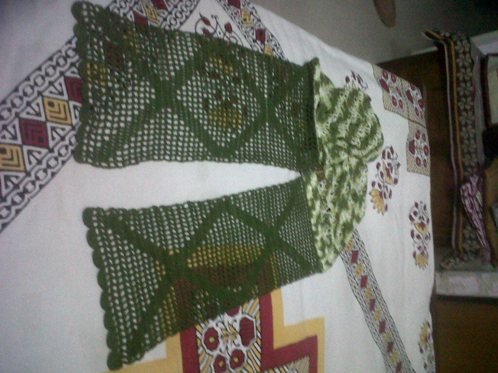 Cross -stitched scarf, made with two kinds of threads.
