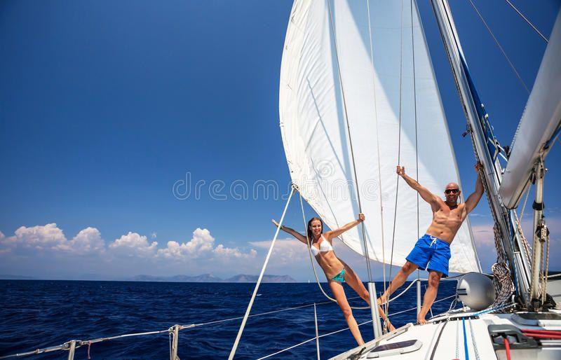 Happy couple on sailboat happy couple having fun on