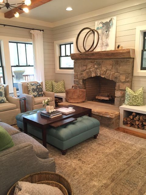 gray shiplap walls, black windows, stone fireplace with bench on side saved from www.design indulgence.com