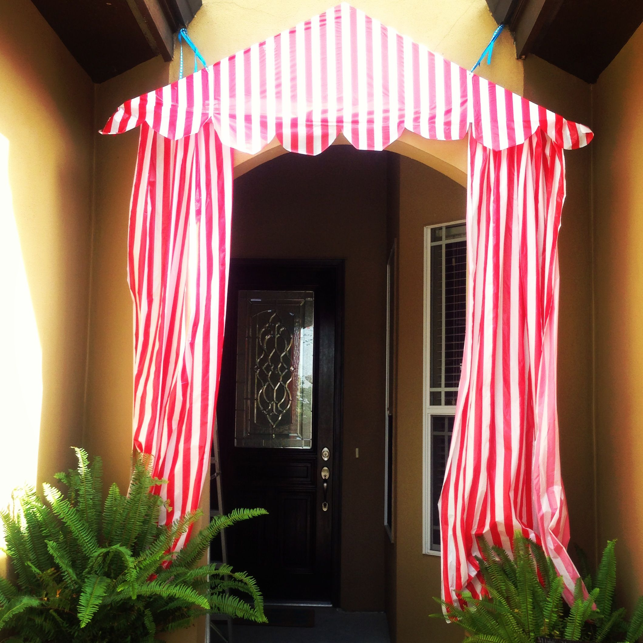 Circus birthday party main entrance, DIY tent. tablecloths from oriental trading over cardboard triangle