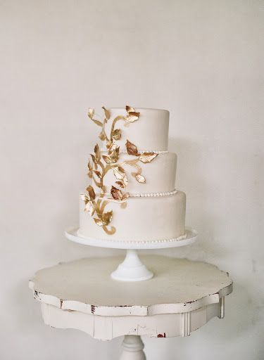 Pure White Wedding Cake Accented With Gold Leaves Wedding