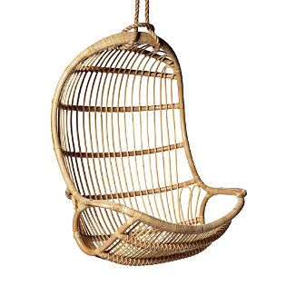 rattan swing would be SO cool with a fur as a cushion or something to soften it up