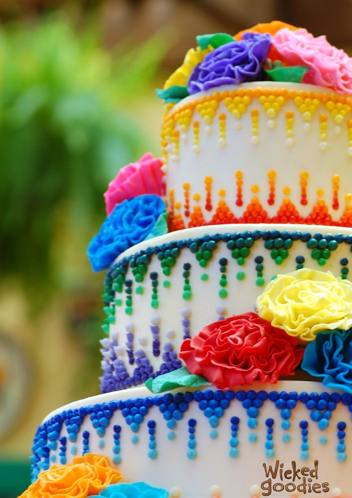 Rainbow cake from Wicked Goodies -- i'd want it to be the colors of the wedding party in a gradient down the cake