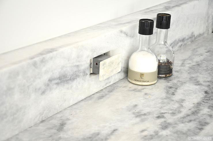 Kitchen Boasts An Outlet Hidden In The Marble Backsplash.