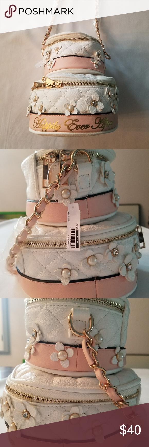 932d06c11ca Aldo Wedding Cake Cross Body Bag Wedding cake bag from Aldo  brand new with  tags! 100% Polyurethane Imported Textile lining Zipper closure 21
