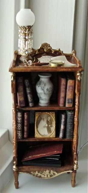 This wonderful bookcase in my faux Burled Amber Walnut with 24k Gold Leaf embellishments, is filled with eight of my handcrafted leather books, a
