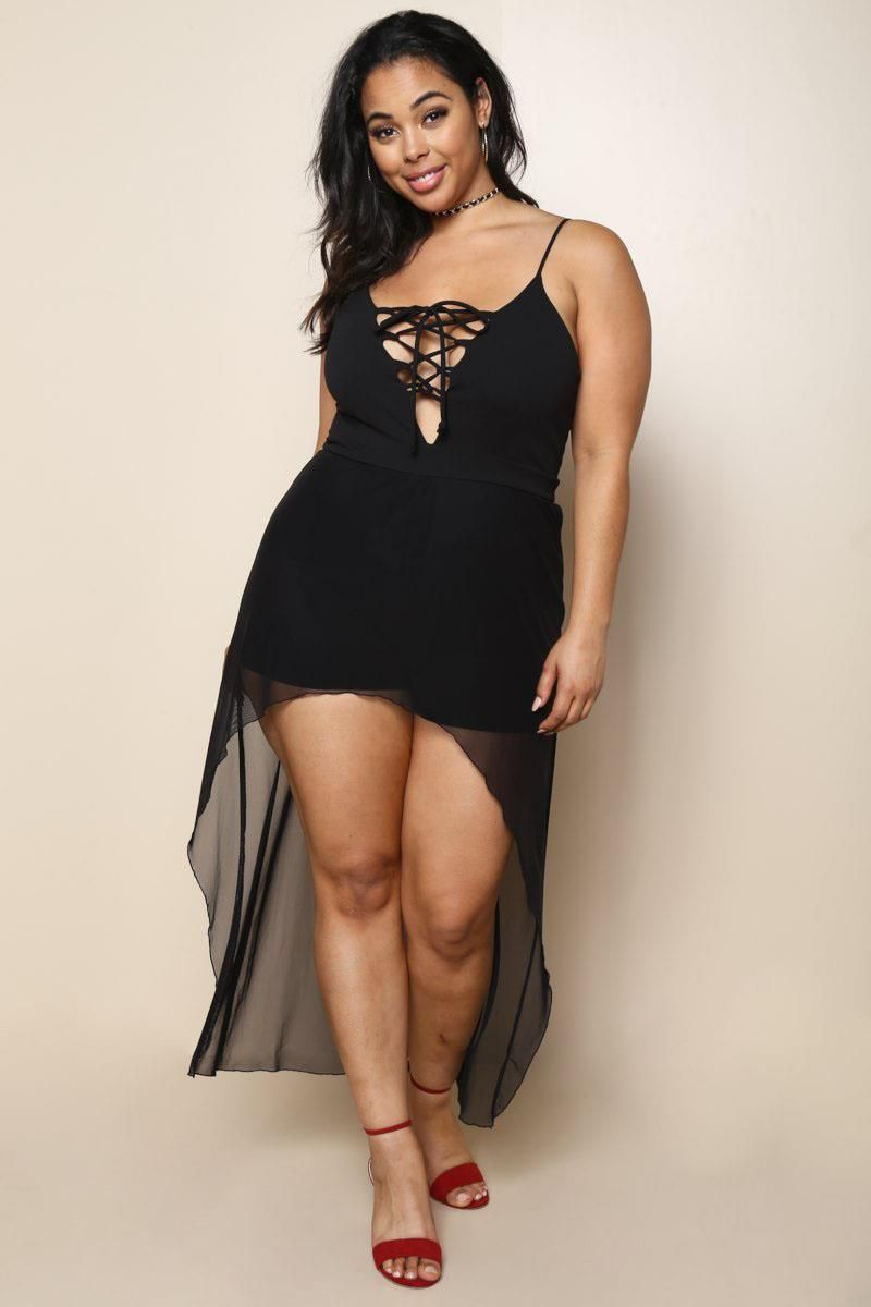 b84e33f41f A plus size maxi dress with built-in romper bottoms and sheer flowy skirt.