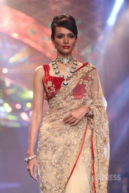 d8fca87b9512f0 Red velvet sleeveless blouse with golden beige designer saree on runway