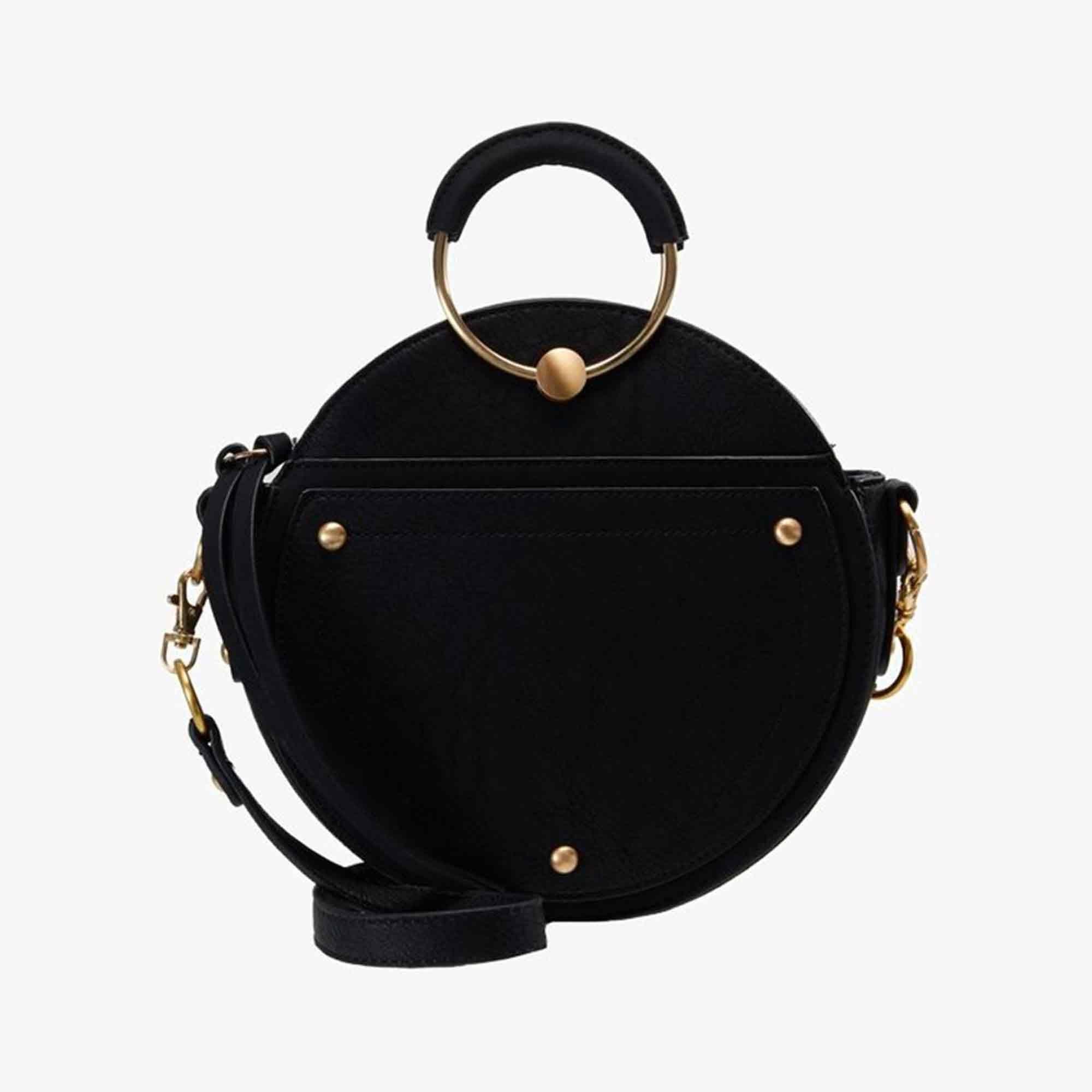 Allez-vous adopter le sac rond cet hiver     Sac à main tendance   Bags 95ca169063bc