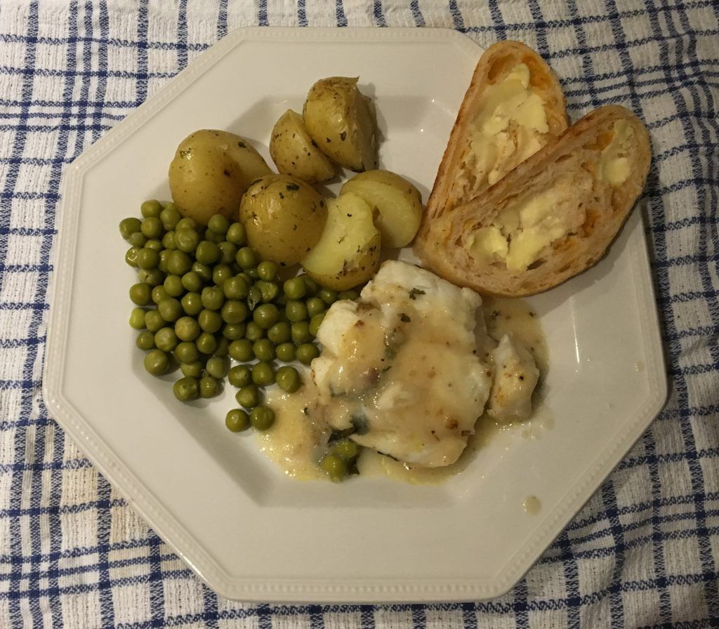 cod fillet on plate with lemon and parsley Fillet