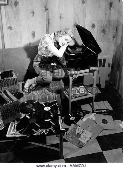1950s Teen Girl Listening To Music On Phonograph Sit On