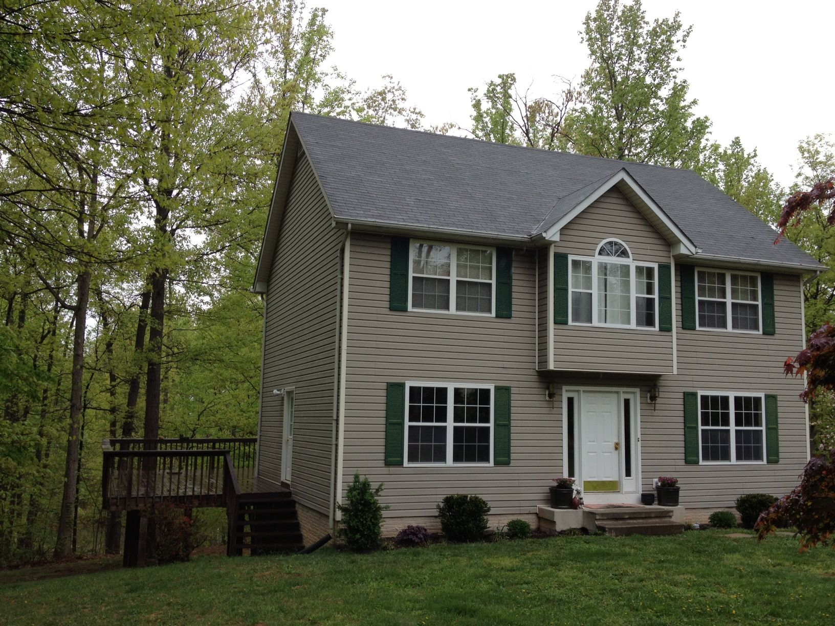 Large rear deck overlooking ponds wraps around side. Enter from kitchen or family room. Perfect for entertaining.