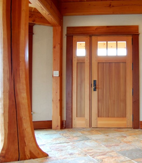 Crafted of western red cedar this entry door is 3 thick for Front door frame