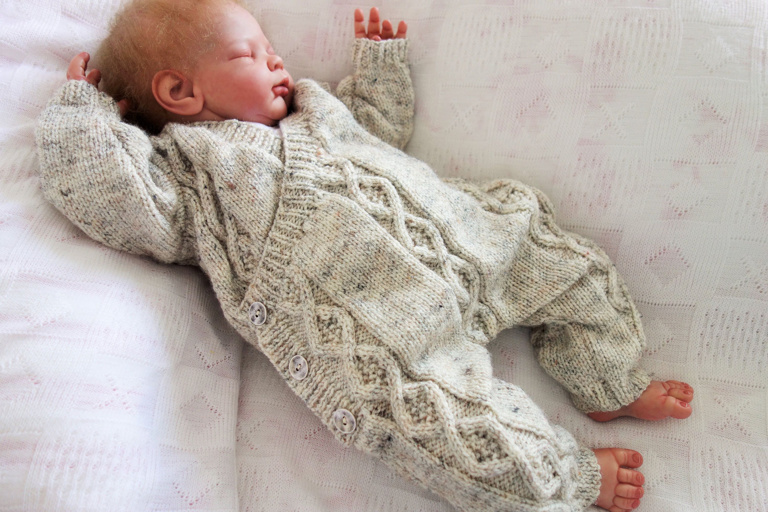a6d5464d5 Hand knitted all-in-one romper suit onesie with cross over fronts