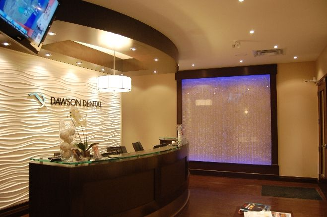 beautiful dental office reception area calming waterfall