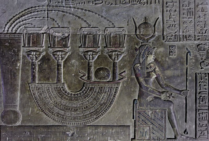 [EGYPT 29608]  'Menat necklace in Dendera.'    	The crypt below the southern wall of the Hathor Temple at Dendera was used for the safe keeping of several sacred objects and statues used in the rites of Hathor. On the walls of the crypt these objects are depicted in reliefs and described in some detail.  Here we see such an object: a Menat necklace, which, when held in the hand and shaken, produced a rustling sound that was thought to please the goddess Hathor. The object consisted of a ...