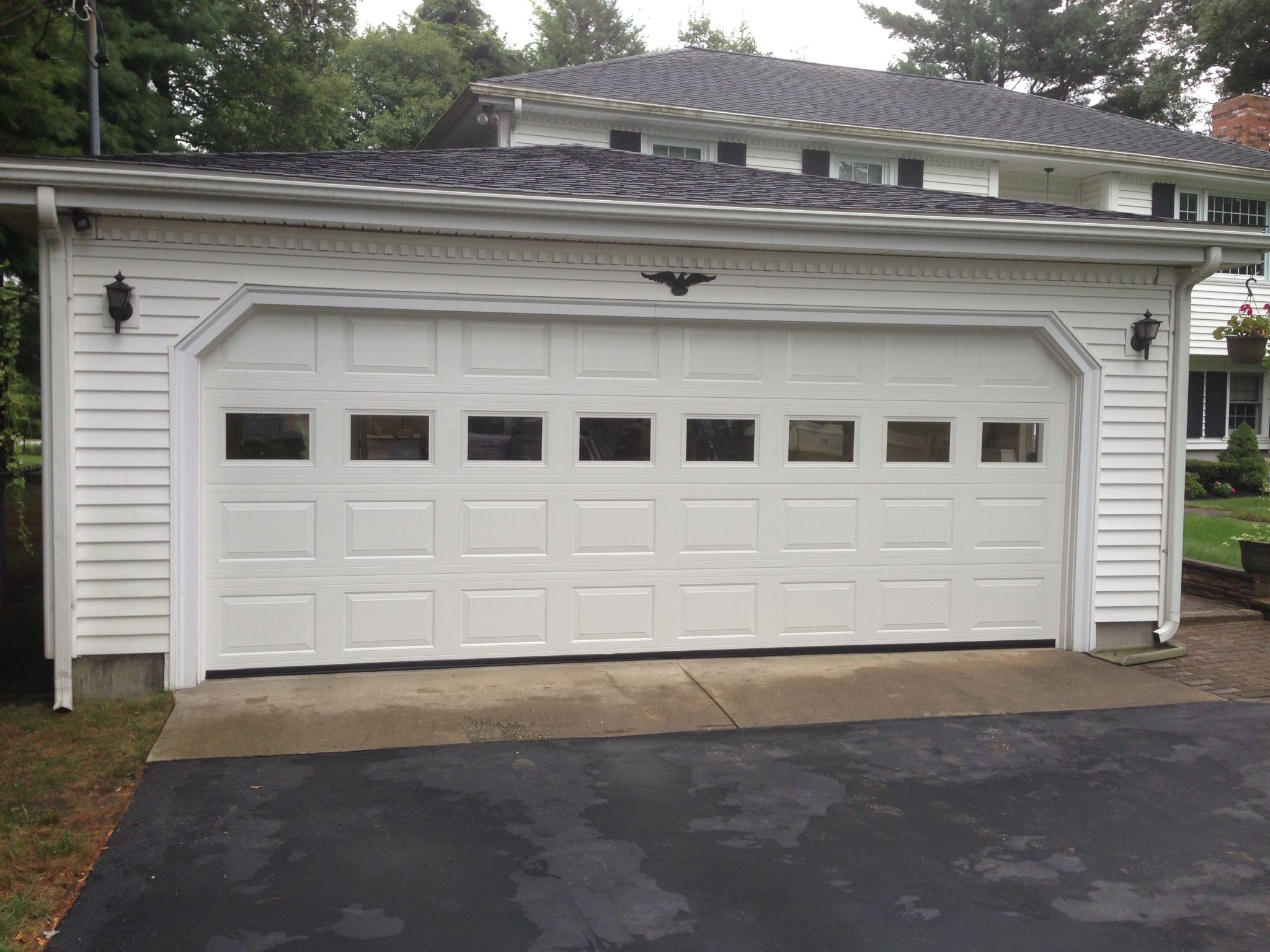 Haas Model 680 Steel Raised Panel Garage Doors In White With Plain Glass Installed By Mortland Overhead Doo Garage Doors Garage Door Panels Garage Door Styles