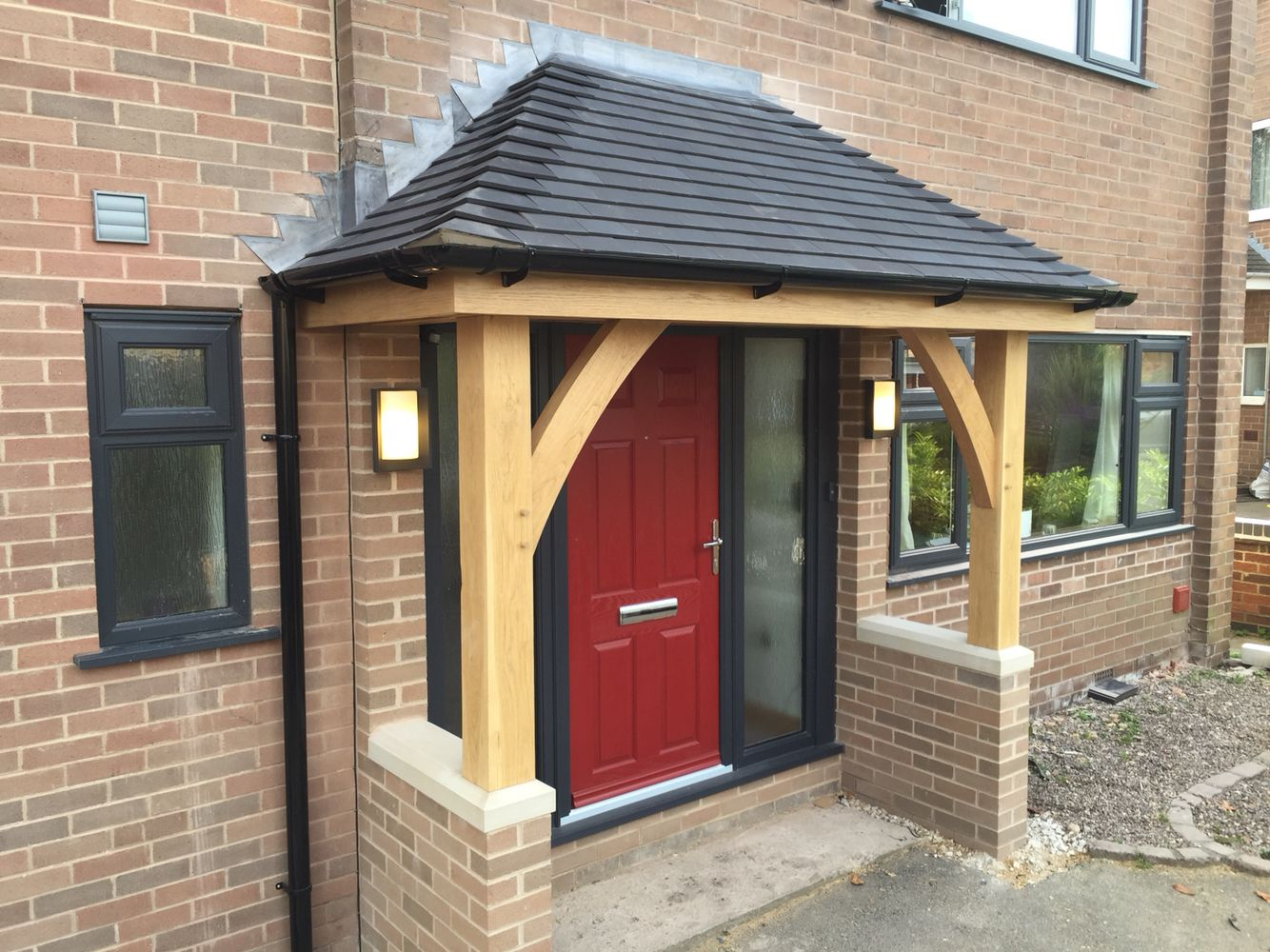 Green oak porch at stramshall with a more modern style and a hipped roof