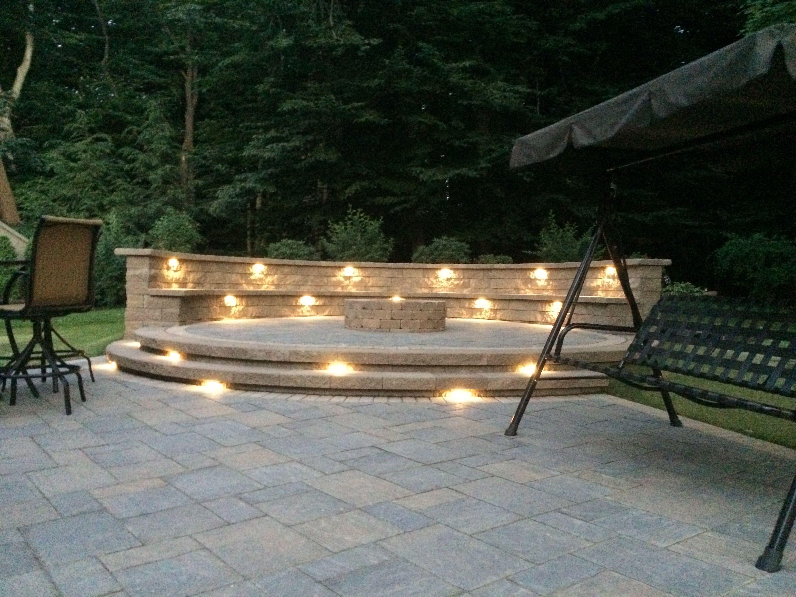 Landscape lights Under cap lights on raised paver patio