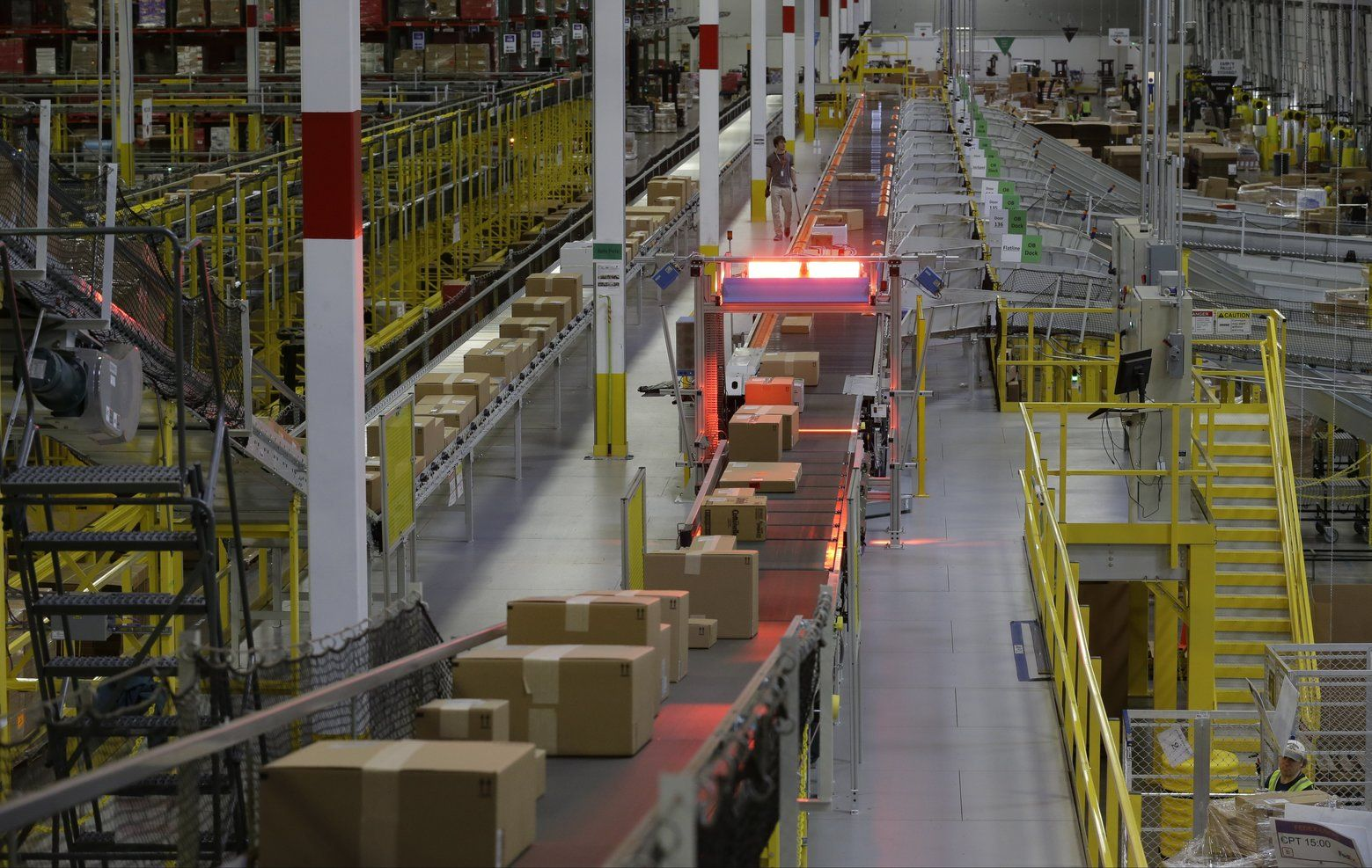 Packages Move On A Conveyor Belt At Amazon S Fulfillment Center In