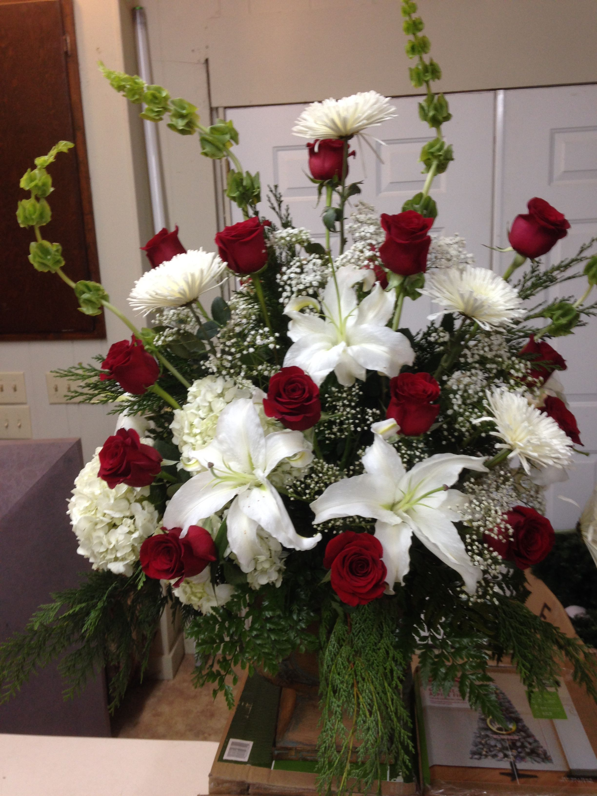 Holiday arrangements wholesale bulk flowers fiftyflowers - Fresh Church Arrangement Using Bells Of Ireland White Lilies White Hydrangeas White Spider