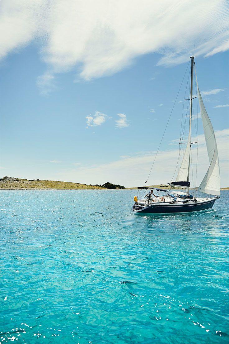 The Skalice yacht sails past Ravni Žakan - one of 89 small islands within Croatia's Kornati national park // photo by Laura Jayne Edwards #croatia #kornati #island