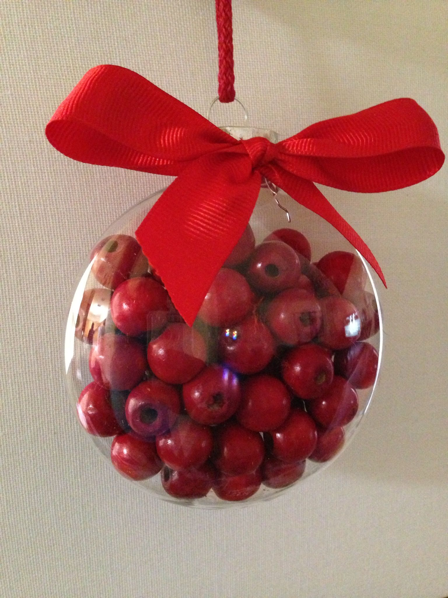 Cranberry wood garland beads in clear ornament container.  Easy DIY Christmas ornament.