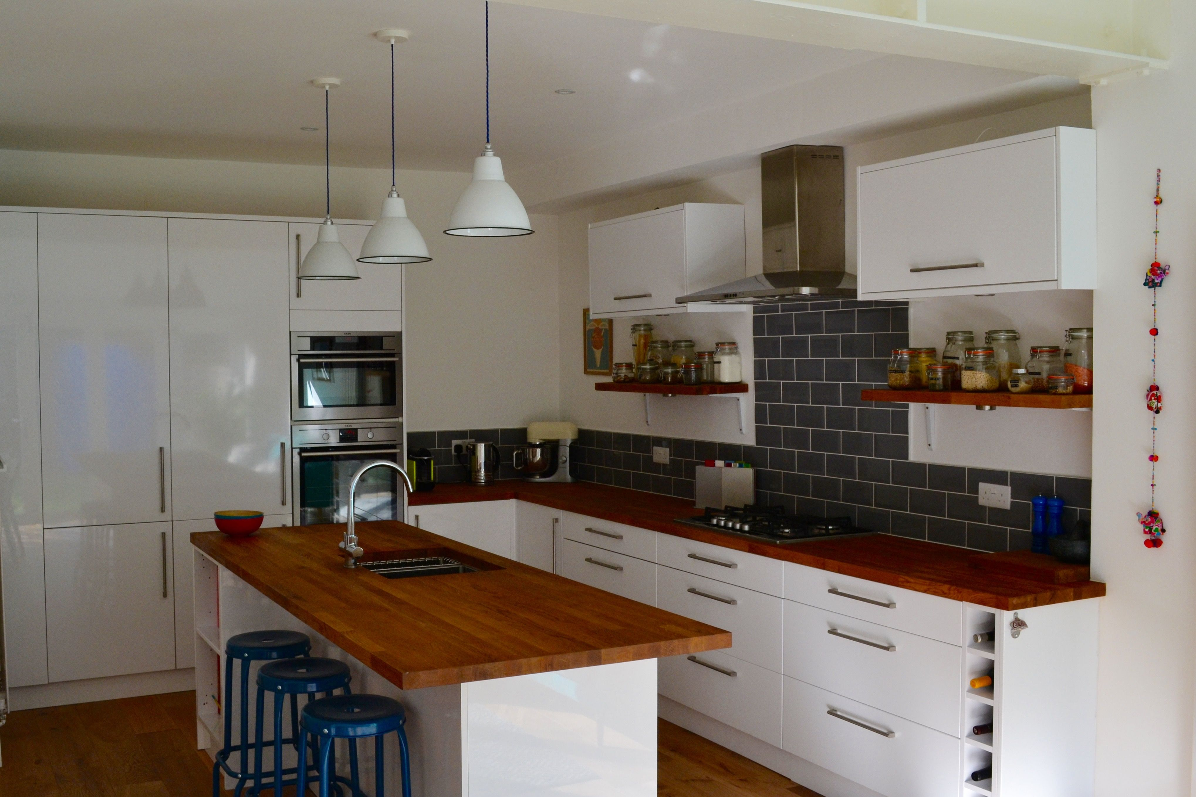 Benchmarx white gloss kitchen with oak worktops and grey