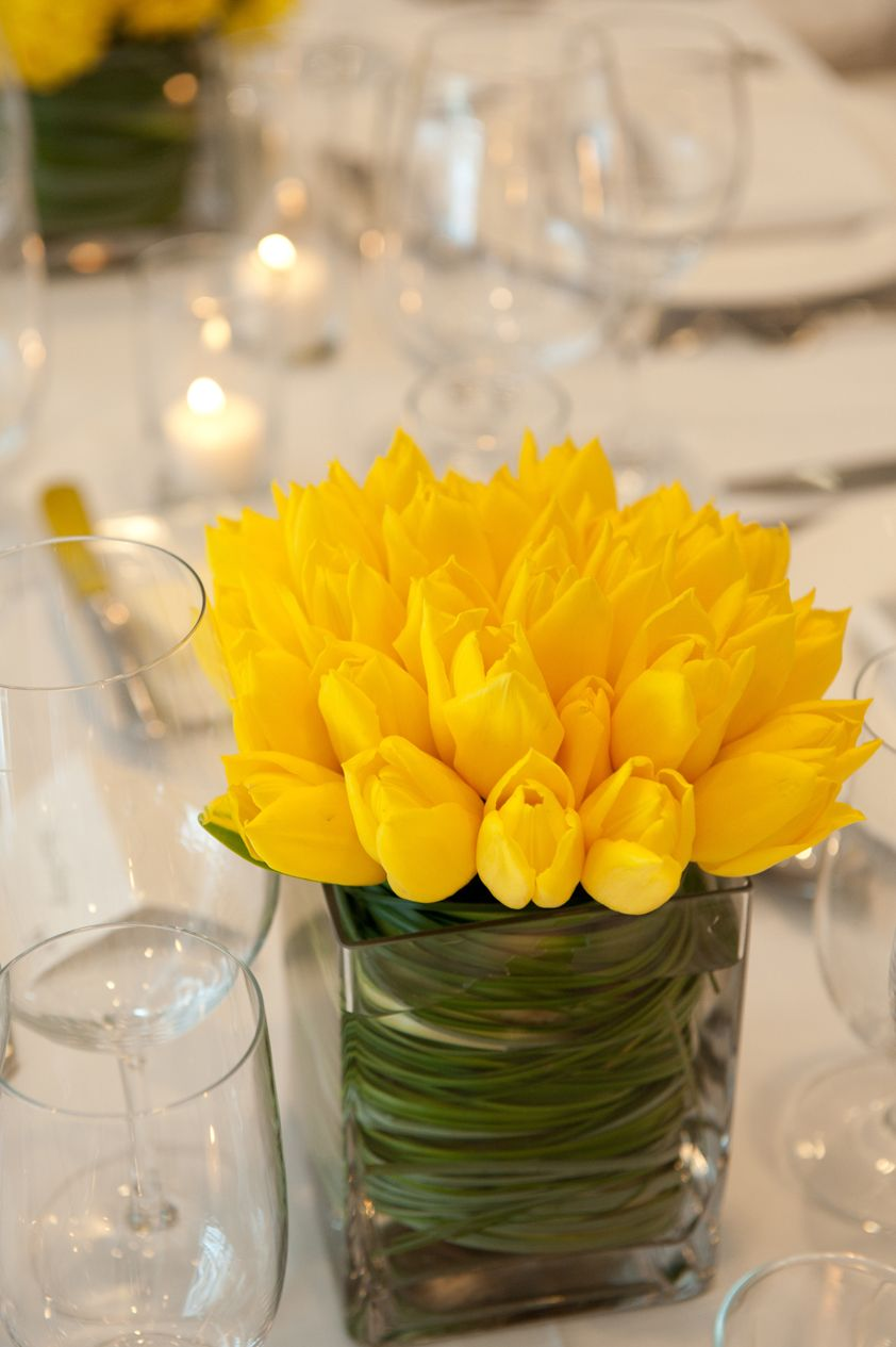 Bright Yellow Tulips And Swirling Bear Grass Centerpiece