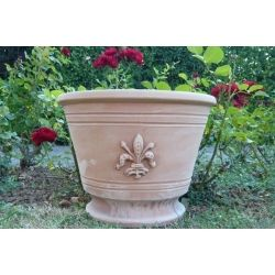 Vase or vessel in handmade antifreeze terracotta, reproducing the traditional Florence lily.Every-day objects suggesting ancient traditions, imperishable in time as moulded in extremely antifreeze clays.