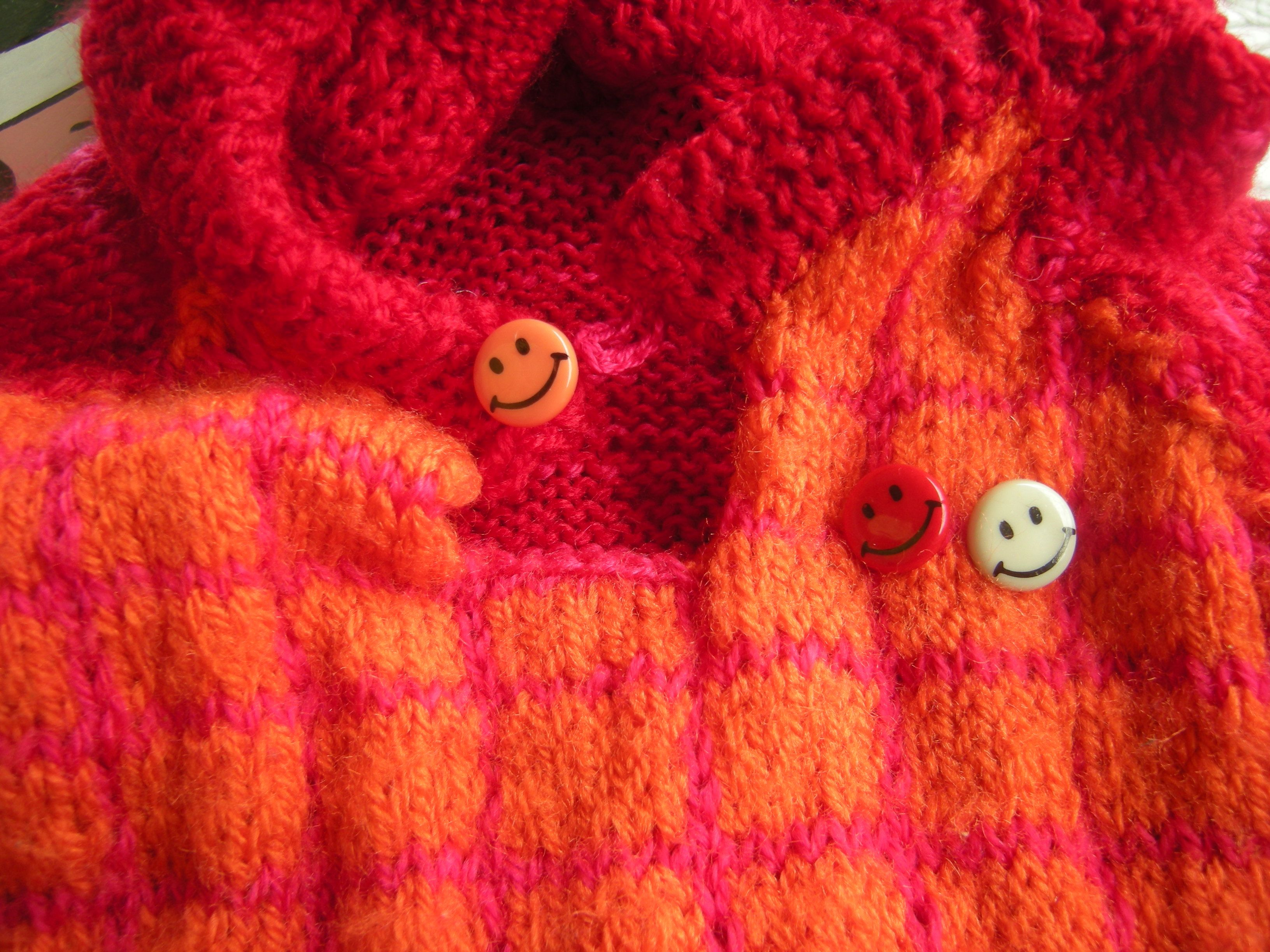 Smiley buttons of my kid's sweater! Barlume Manod'opera