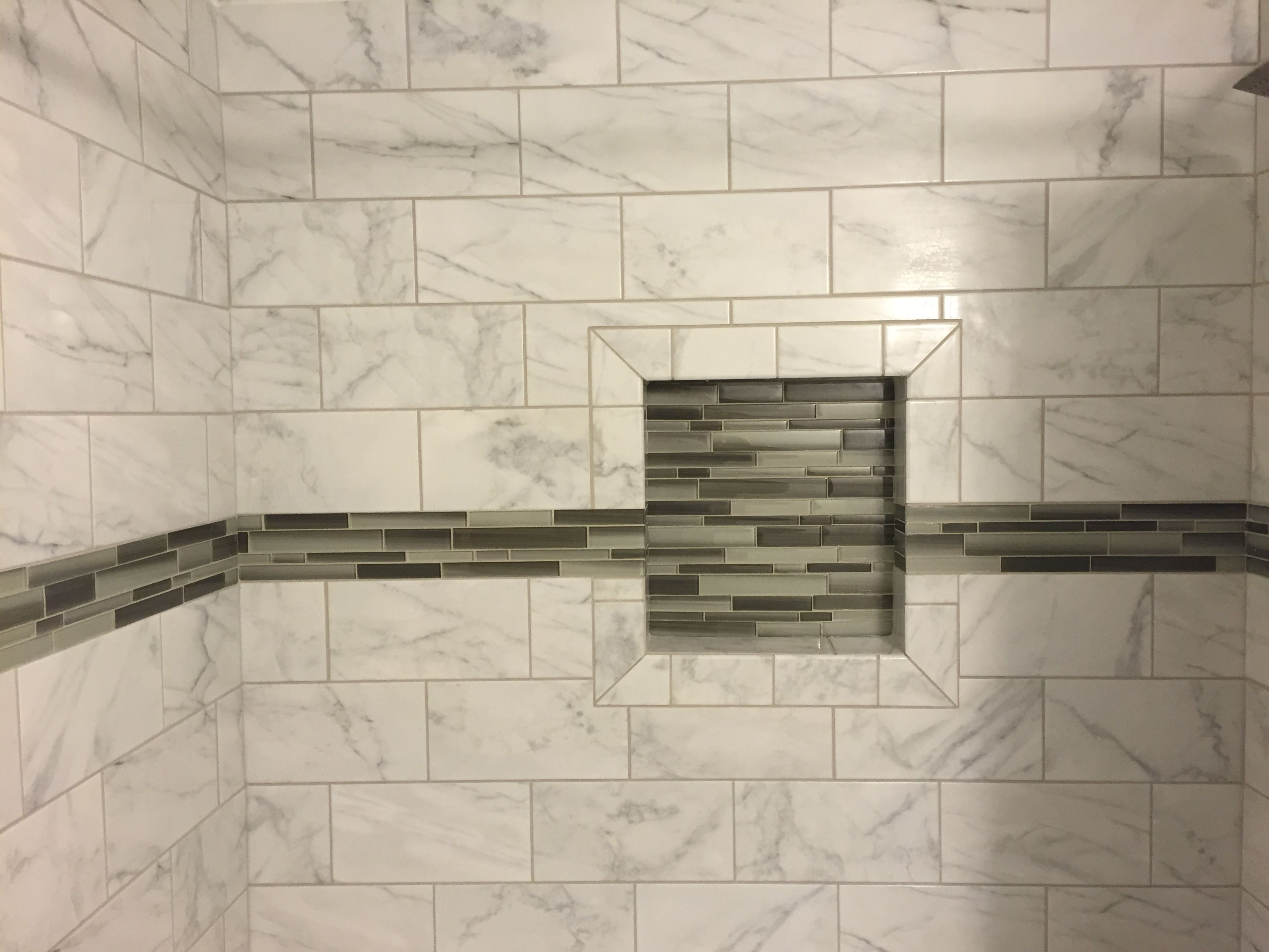 Bathroom remodel with marble tile shower and green glass accent tile ...