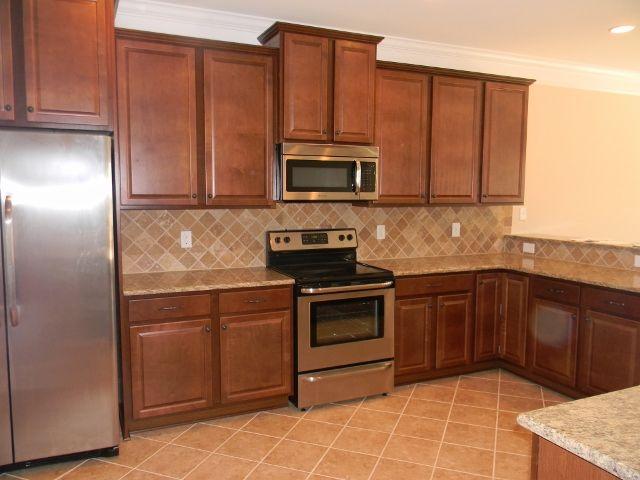 timberlake andover maple nutmeg cabinets santa cecilia granite essex homes design board 11